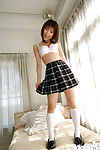 Pretty oriental schoolgirl Akane Sakura erotic dancing off her uniform