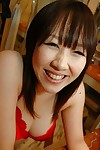 Shy oriental adolescent undressing and exposing her moist love-cage in close up