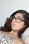 Hottie dark brown Ava Taylor is lying on the sofa and showing her cage of love