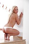 Pretty alluring blonde Naomi Nevena is smiling while masturbating
