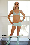 Young blonde girl Bree Mitchells posing in knee high socks and underwear