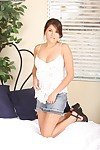 Smoking hot brunette slut Shyla Jennings is posing in a jeans skirt