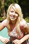 Teen girl Kessy Ros spread her slim legs outdoor at her pool