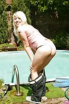 Teen girl Kessy Ros spread her slim legs outdoor at her pool