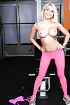 Sporty teen Marsha May poses in her pantyhouse right in the gym