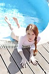 Beautiful European teen Misha Cross getting wet at a pool party