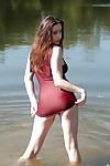 Busty teen chick Ashley Adams masturbating fully clothed beside lake