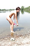 Wet teen babe Cindy T removing panties to pose nude outdoors on beach