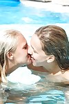 Barely legal lesbian Sara J and her girlfriend share tongue kiss in pool