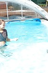 Topless blonde Sara J seduces her teen girlfriend into lesbian sex in pool