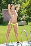 Sexy babe Eva Parcker is posing in the pool naked and masturbating