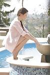 Teen pornstar Taissia Shanti has her sweet legs shown outdoor at the pool