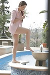 Teen pornstar Taissia Shanti has her sweet legs shown outdoor at the pool