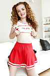 Young babe Marissa Mae poses solo for panty upskirts in cheerleader uniform
