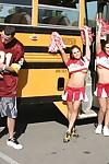 Three slutty cheerleaders starting a fervent orgy in the school bus