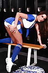 Hot cheerleader Kortney Kane taking off her uniform and spreading her legs