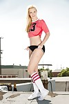 Blonde cheerleader Samantha Rone modeling outdoors in knee high socks