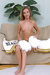 Naughty blonde cheerleader getting naked and exposing her goods