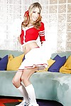 Seductive teen blonde Natalia Rossi slipping off her cheerleader outfit
