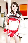 Naughty teen girl Emily Grey posing solo in sexy cheerleader uniform