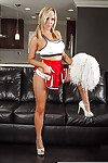 Sexy babe cheerleader Tasha Reign is posing with naked boobies