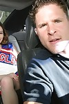 Frisky teenage cheerleader revealing her goods on the back seat