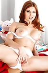 Petite redhead cheerleader Sarka getting naked and spreading teen pussy