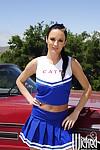 Cheerleader Alektra Blue shows her ass upskirt and spreads her legs
