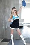 Pretty blonde cheerleader Jillian Jensen striking sexy poses in pigtails