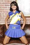 Hot latina cheerleader Nyla Danae slipping off her uniform and panties