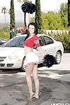 Naughty dark haired pornstar Brooklyn Daniels strips in a parking lot