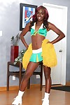 Black-skinned cheerleader Bella Doll is dancing naked on the camera
