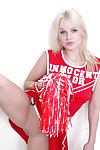 Schoolgirl cheerleader Kylee is a blonde babe that is undressing for us