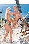 Jennifer and nesty force up their apple bottoms on the beach