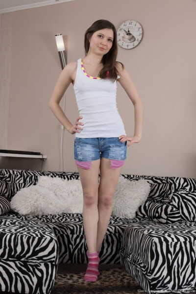 Adolescent female Slava Sanina plays with her all standard gentile and pubic hairs