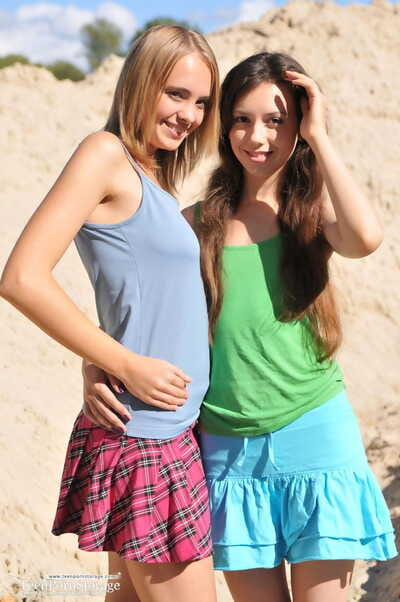 Young pretties Dana and Lisa take the exposed modelling plunge mutually on beach dune